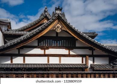 Roof detail with the specific roof tiles of a traditional Japanese Shrine complex in Gion District, Kyoto, Japan.