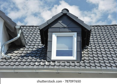 Roof with Dormer Windows on a residential Building