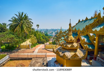 The roof of Eastern stairway of Shwedagon Zedi Daw and the lush green garden, occupying the slope of Singuttara Hill, Yangon, Myanmar.
