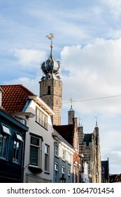 The roof and facade of the old city in Holland. Travels in Europe. Blue sky with clouds