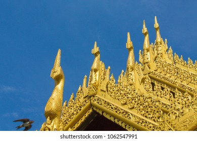 The roof and golden pagoda of Burmese temple.