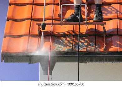 Roof and gutter cleaning with high pressure