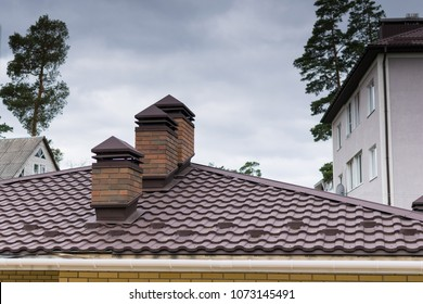 The roof of the house with chimneys.