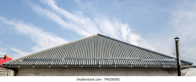 The roof of the house is made of galvanized metal