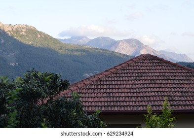 roof house on the mountains background