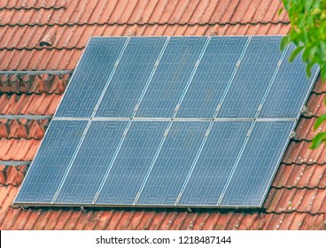 Roof of a house with photovoltaic solar cells on the roof for alternative energy production