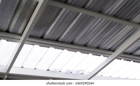 roof of house with roof tiles and transparent sheets with insulation foil protect heat from the sun.