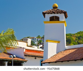 Roof of the house under blue sky in Puerta Vallarta, Mexico