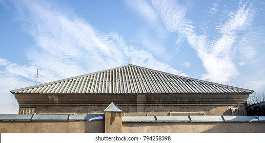 The roof of the house from wavy asbestos-cement sheets