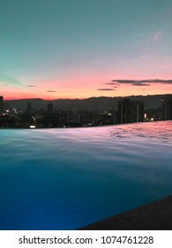 Roof Infinity Pool with Colored Sunset View