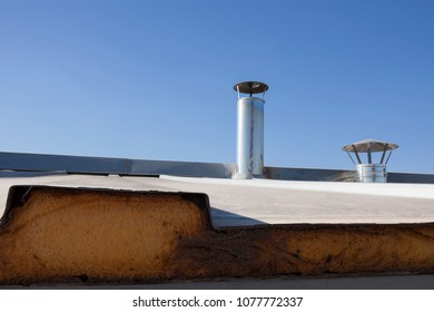 Roof insulated with polyurethane foam. Industrial climate system machinery room