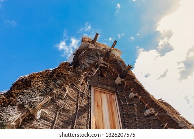 Roof of Japanese vintage wooden house , called Minka or gassho zukuri, with clear blue sky. Shirakawago, Gifu prefecture, Japan.
