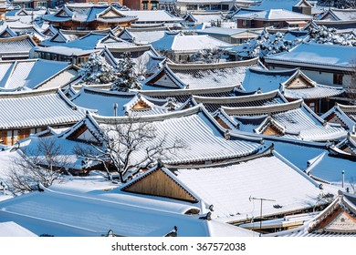 Roof of Jeonju traditional Korean village covered with snow, Jeonju Hanok village in winter, South Korea.