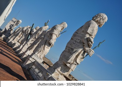 The roof of Maderno's Facade of Saint Peter's Basilica, features statues of Jesus and 11 of the Apostles along with John the Baptist. Vatican city