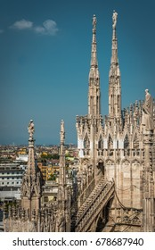 The roof of Milan Cathedral (Duomo di Milano) in Milan, Italy. Architectural detail on the blue sky. Milan Duomo is the largest church in Italy and the main travel attraction of Milan. Vintage photo.
