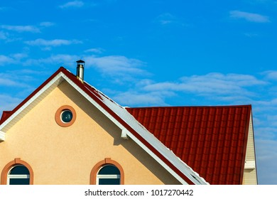 Roof of a new built house with nice window and chimney