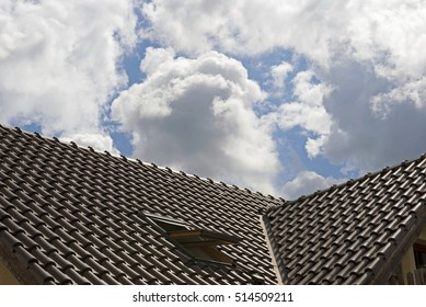 Roof, new roof and dramatic clouds, as the background