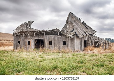 The roof of an old barn on a farm near the town of Oakesdale, Washington is collopasing into itself.