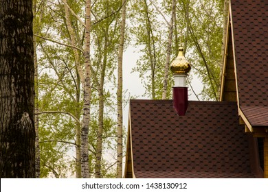The roof of an Orthodox church against the sky and against the background of poplars. Excellent background for the Orthodox.