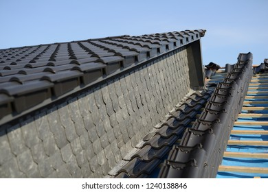 roof in progress: processing new tiles on residence