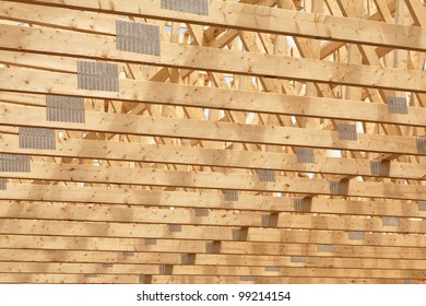 Roof rafters in the new construction of a wooden building or house.