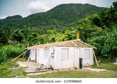 Roof Repair in Puerto Rican Mountains after Hurricane Maria