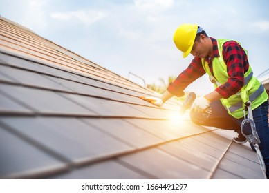 Roof repair, a Specialist in Roof Forming, is the Replacement of roof plates that have been used for a Long time. - Shutterstock ID 1664491297