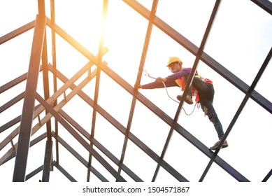 Roof repairman, construction engineer wearing safety inspection kit in Asia