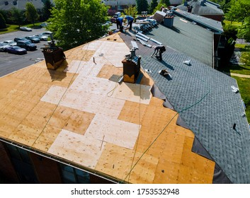 Roof repairs old roof replacement with new shingles of an apartment building - Shutterstock ID 1753532948