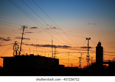 The roof of a residential house on a background of dawn