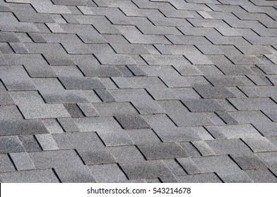 The roof shingles as a background or texture.