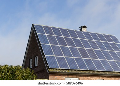 roof with solar panels and blue sky
