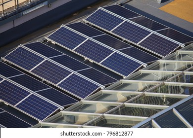 Roof solar panels technology - photovoltaic electricity cells installation in London, UK.