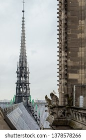 The roof and the spire of Notre Dame Cathedral. Around the spire, the bronze figures of the apostles and the evangelists. Collapsed during the fire 2019