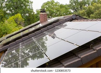 Roof surface of home with black solar collectors