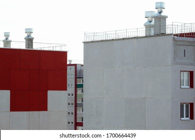 The roof of a tall multi-story concrete building. Architecture and Real Estate