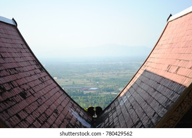 The roof of temple on mountain when we seeing view below have to city and natural to good feeling.