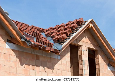 Roof tile packages ready to be laid on the roof