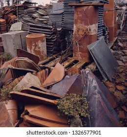 Roof tiles and chimney pots at a salvage yard in the UK.