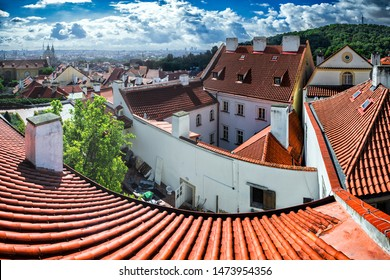 Roof tiles and eaves of Prague old town on sunny summer day