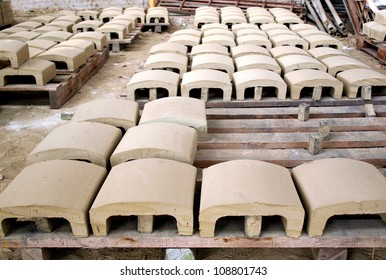 Roof tiles made from clay are drying before being fired