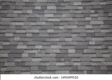 Roof tiles or shingles typical of the northwestern pacific coast: wooden texture and geometrical patterns