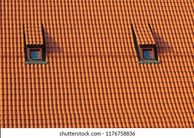 Roof with a roof tiles with two small windows.
