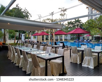 Roof top pool, Park Hotel Clarke Quay, Singapore – March 22 2019: roof top pool and bar setting at Park Hotel Clarke Quay. Summer time chill vibes.