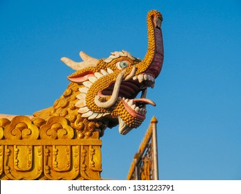 the roof top of temple in Nepal is decorated with the animal sculpture which look like a dragon and animal combination together.