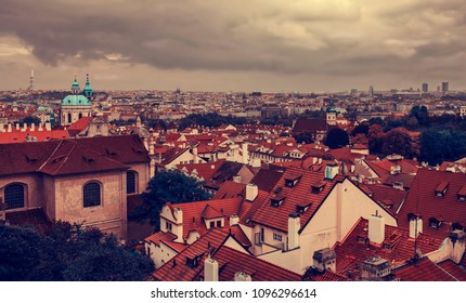 Roof tops view of Prague city with church dome before rain, Czech Republic