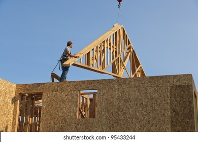 Roof Trusses Being Hoisted Onto Roof