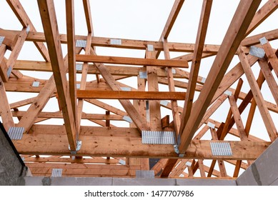 Roof trusses not covered with ceramic tile on a detached house under construction, visible roof elements, battens, counter battens, rafters.
