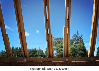 Roof trusses not covered with ceramic tile on a detached house under construction, visible roof elements, battens, counter battens, rafters. Industrial roof system with wooden timbe