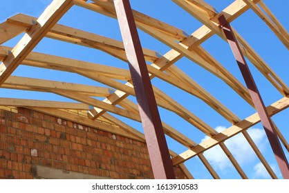 Roof trusses not covered with ceramic tile on a detached house under construction, visible roof elements, battens, counter battens, rafters. Industrial roof system with wooden timber